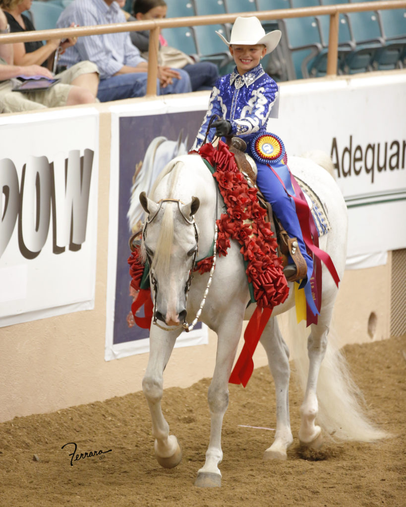 Brinley winning Western Seat Equtaion on Dylan SA at youth '13